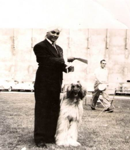 KORLA SHOWING ONE OF HIS AFGHAN HOUNDS